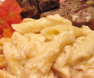 Mark's favorite dinner is lamb chops served with macaroni & cheese and a side of stewed tomatoes.
