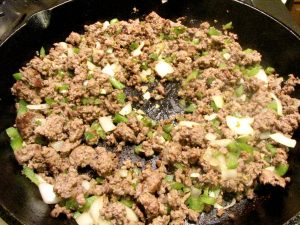 Get the meat good and brown. Don't worry about letting the onions and peppers cook too much at this point because you will simmer the dish.