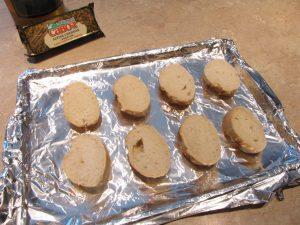 Slice the bread. Allow two per bowl.