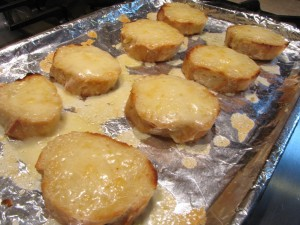 Grate 3 oz. of cheese on the toasted bread and place under the broil until bubbly.