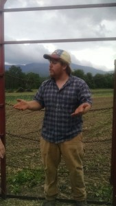 We toured the farm on a hay wagon pulled by a tractor. Here Farmer Jon is explaining how they rotate their crops. Kale is growing in the background.