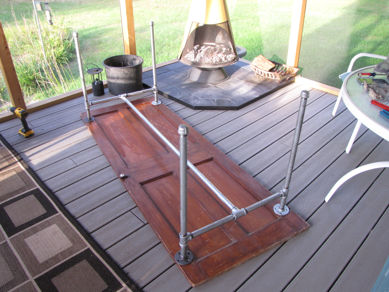 DIY Table Made From An Old Door And Galvanized Pipe