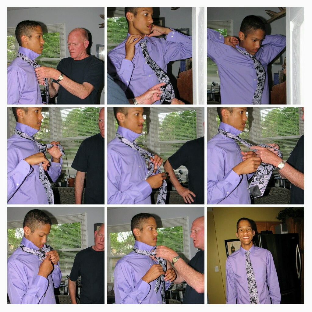 boy learns how to tie a tie