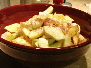 Stir the apples, sugars, flour and spices - place in pie crust.