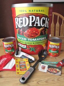 I love this tin and you will too. It comes with two cans of RedPack tomatoes, recipes, oven mitt, spaghetti stirrer and can opener.