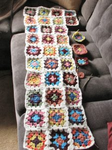 Granny Square Afghan, or as I call it, The Stash Granny. Slowly but surely making progress and using up the bits and pieces of my yarn stash.