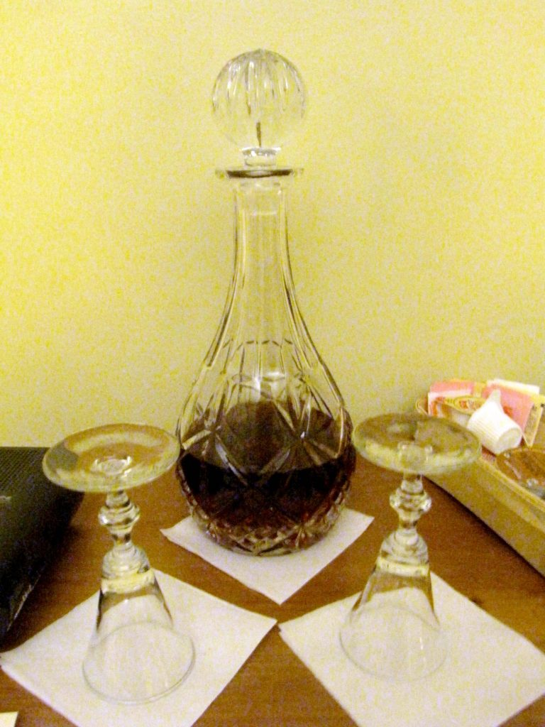 Decanter of sherry in historic Beekman Arms hotel room.