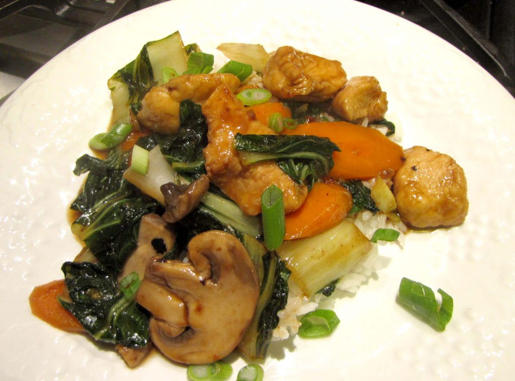 chicken stir fry topped with scallions