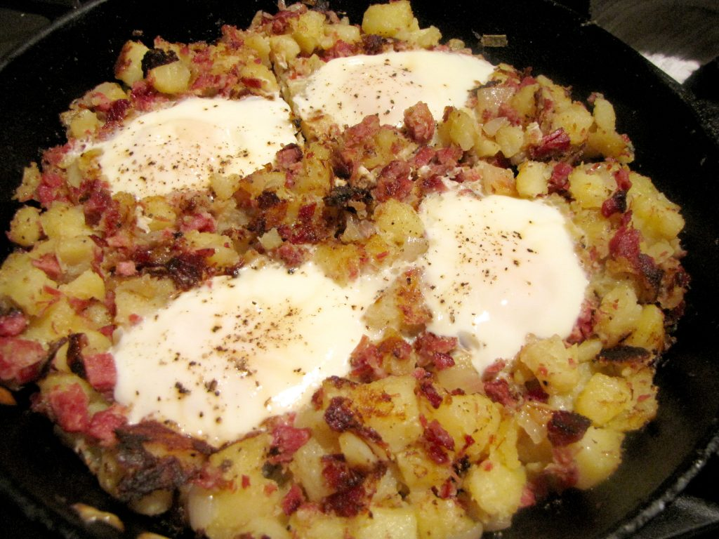 Poach eggs in one pan with the corned beef