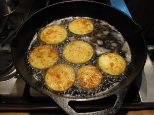 """Combine equal parts of canola and olive oil in a large saute pan - enough to cover the pan by 1/4""""."""