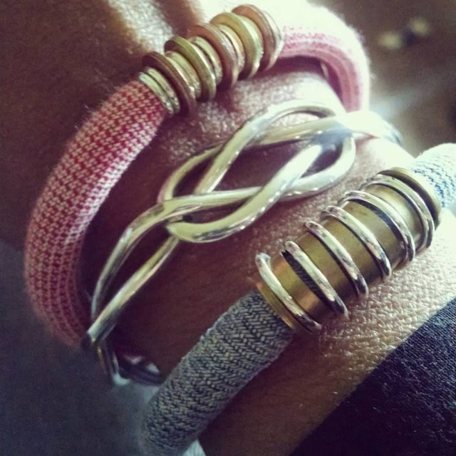 Rocking layered bangles today Pretty upcycled cloth ones from razimusjewelryhellip