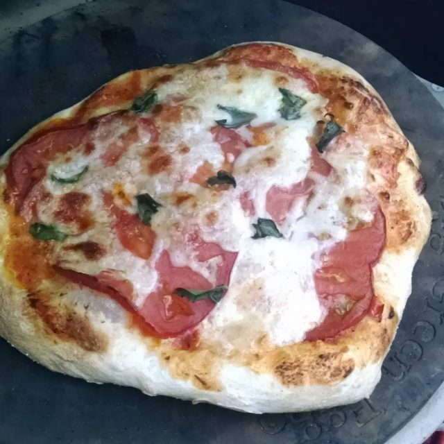 Making a simple pizza on the biggreenegg fridaynightin