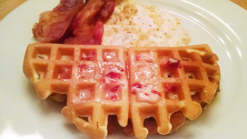 plate with waffle, eggs and bacon